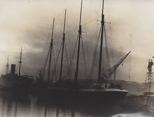 'Huswig', Peruvian schooner, ex-Danish 'Wanekong', shows her in Cammel Lairds wet basin for repairs. She left Preston for Norway and met with terrific headwinds. In 7 days she was only off the mouth of the Mersey and had lost most of her sails and had most of her crew injured. She put into Mersey for repairs.