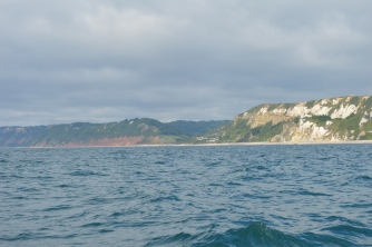 Beyond the white cliffs around Beer lies Branscombe and the familiar red cliffs of Devon.